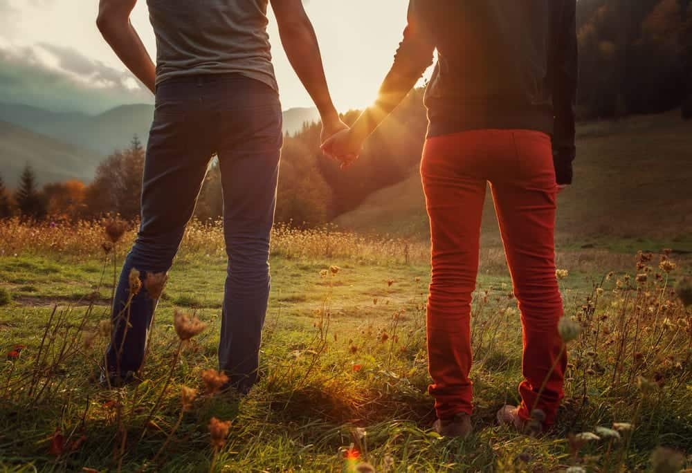 couple holding hands looking at mountains at a Gatlinburg cabin